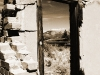 Crumbling door of old homestead