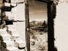 Crumbling door of old homestead